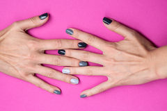 Delicate female hands with a stylish neutral Stock Photos