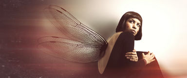 Delicate, feminine fragility. Young woman with wings. Royalty Free Stock Photo