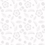Delicate floral seamless background with flowers and leaves . Stock Images