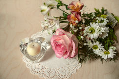 Delicate flowers with pink rose and crystal candlestick heart Stock Photography