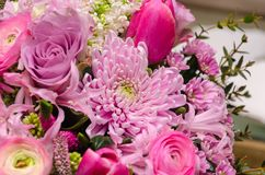 Delicate fresh bouquet of fresh flowers with pink Ranunculus, ro. Se, astra and chrysanthemum. Background for birthday gifts Stock Photos