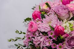 Delicate fresh bouquet of fresh flowers with pink Ranunculus, ro. Se, astra and chrysanthemum. Background for birthday gifts Royalty Free Stock Photo