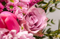 Delicate fresh bouquet of fresh flowers with a pink rose. Royalty Free Stock Photos