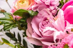 Delicate fresh bouquet of fresh flowers with a pink rose. Royalty Free Stock Photography