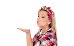 Delicate girl blowing her hand in pinup style Stock Photos