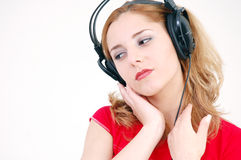 Delicate girl with headset Stock Images