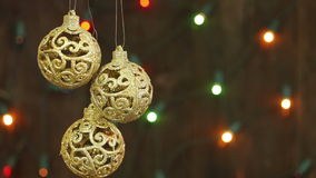Delicate golden balls on the background of garlands blinking. stock footage