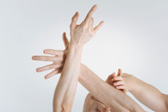 Delicate gymnasts hands expressing elegance in the studio. Delicate skin. Flexible tender sophisticated gymnasts hands locating in the white colored studio and royalty free stock photos