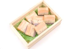 Delicate handmade soap and wooden box Royalty Free Stock Photos