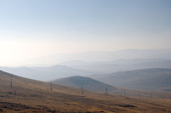 Delicate haze of morning mist over the valley. hilly landscape. Savannah, grassland . Stock Images
