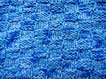 Delicate knitted fabric texture blue Stock Photography