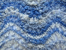 Delicate knitted fabric texture blue Stock Image