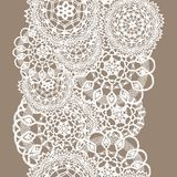 Delicate knitted lace of round doilies, seamless pattern - white silhouette on beige background. Vector illustration stock illustration