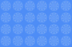 Delicate lace pattern. In white on a blue background Royalty Free Stock Image