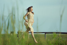 Delicate lady running on the meadow Royalty Free Stock Photos