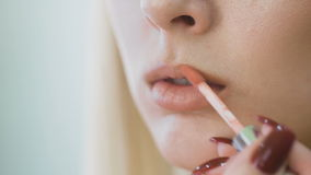 Delicate lips of a young girl. Perfect make-up on the skin radiant blonde. stock footage