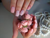 Delicate manicure of nails with decoration Stock Images