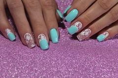 Delicate nails white with blue Stock Photos