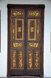 Delicate Peranakan wood carved door with gold inlay Penang Malaysia Royalty Free Stock Images