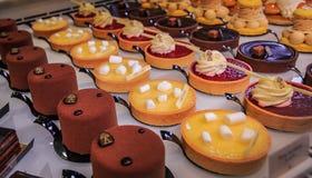 Delicate petit fours desserts at the famous tea house Angelina on Rue de Rivoli in Paris France. Paris, France - January 21, 2015: Delicate petit fours desserts stock images