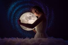 Free Delicate Photography, Astrology, Women`s Magic. Beautiful Attractive Girl On The Background Of The Universe And The Stars Hugs Th Royalty Free Stock Image - 190499256
