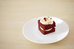Delicate piece of small chocolate cake with shallow depth of field Stock Images