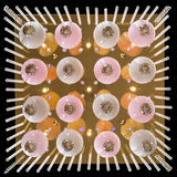 Delicate pink chandelier of color lamp bulbs isolated on black Stock Photography
