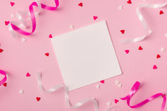 Delicate pink party background with streamers for celebrating wi royalty free stock image
