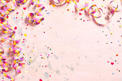 Delicate pink party background with streamers Stock Photography