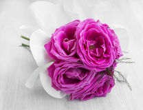 Delicate pink roses in a bouquet on white painted wood Stock Photo