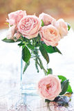 Delicate pink roses. In a glass vase on the table Royalty Free Stock Photography