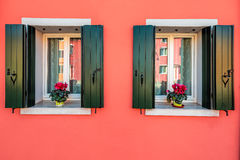 Delicate pink wall. With two windows of houses on the famous island Burano, Venice, Italy Stock Images