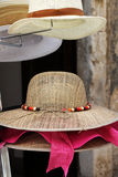 Delicate straw hats on a stand Stock Images