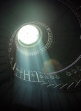 Delicate sunlights among spiral stairs Royalty Free Stock Images