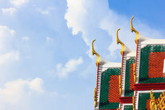 Delicate Thai art at roof top of Buddhist temple in Bangkok, Stock Photos