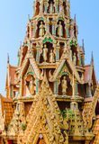 Delicate Thai art rooftop of temple  with several buddha staues Royalty Free Stock Photo
