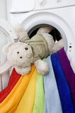 Delicate wash: Washing machine, toy and colorful laundry to wash Royalty Free Stock Photos