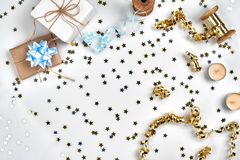 Delicate wavy ribbons and metallic star shaped confetti isolated on white background. Christmas holidays decoration royalty free stock image