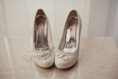 Delicate wedding jewelry, rings and wedding shoes Stock Image