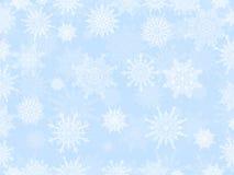 Delicate white Christmas snowflake background light blue Stock Photos