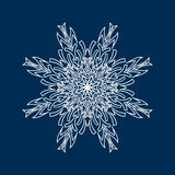 Delicate white Christmas snowflake on blue background Stock Image
