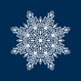 Delicate white Christmas snowflake on blue background Royalty Free Stock Images