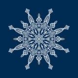Delicate white Christmas snowflake on blue background Stock Photo