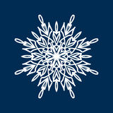 Delicate white Christmas snowflake on blue background Royalty Free Stock Photography
