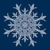 Delicate white Christmas snowflake on blue background Royalty Free Stock Image