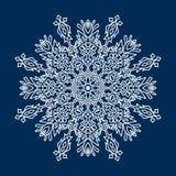 Delicate white Christmas snowflake on blue background Royalty Free Stock Photos