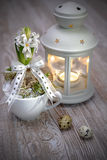 Delicate white pearl hyacinth with white lantern and quail eggs Stock Photo