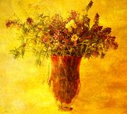 Delicate wild flowers in the red vase Royalty Free Stock Photo