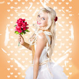 Delicate young woman holding flower bunch Stock Image