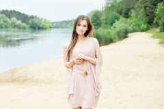 Delicate young woman in white dress Royalty Free Stock Photo